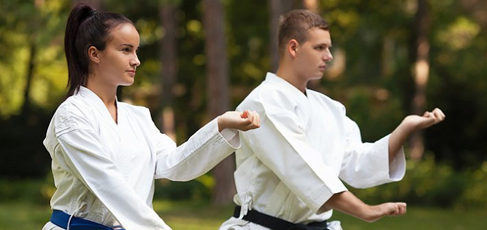 Two people practicing tai chi