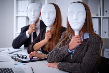 Business people with blank masks