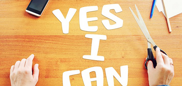 Letters cut out spelling 'yes I can'